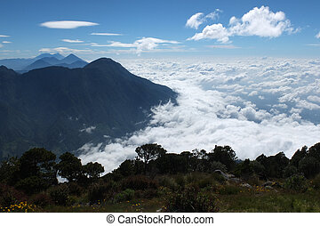 Sea of clouds from the summit of the Santa Maria volcano,...