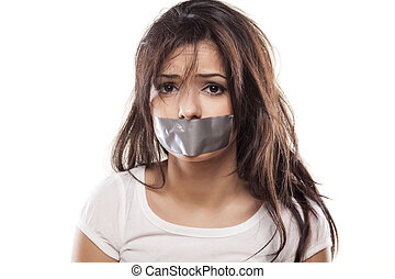 shut up girl - upset girl with self-adhesive tape over her...