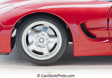 sports car - red sports car on a wooden background