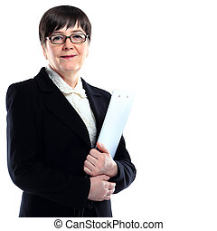 Mature adult businesswoman in a black suit holding a black...