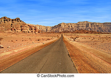 Road through red mountains in Israel.
