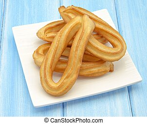 Several fried churros with olive oil typical of Spain