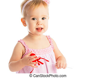 Happy baby girl with red heart isolated