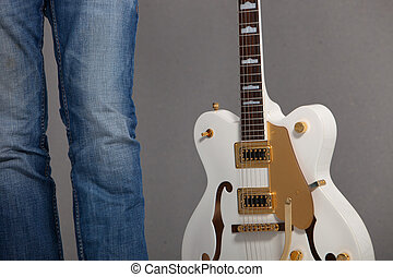 Man holding a white electric guitar - Close-up view of the...