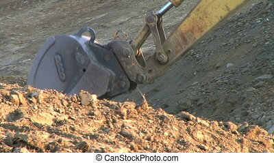 Excavator Bucket - Closeup of crawler mounted backhoe bucket...