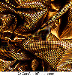 Luxurious metallic gold fabric arranged in soft folds for a...