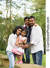 happy outdoor indian family in the park
