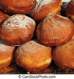 deep fried doughnut covered with powdered sugar