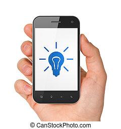 Finance concept: Light Bulb on smartphone - Finance concept:...