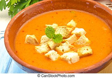 Cold gazpacho soup with tomato, bread, ham and vegetables
