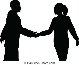 Handshake of business people standing up in silhouette