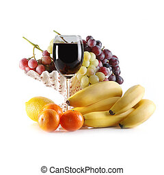 different fruits and glass of wine on white