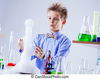 Nosy schoolboy watching reaction of experiment - Image of...
