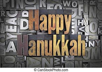 Happy Hanukkah written in vintage letterpress type