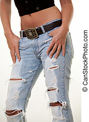 Ripped jeans - Bottom part of a womans body wearing ripped...