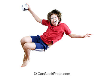 Jumping boy with a ball