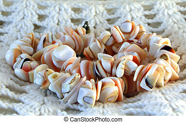 Coral beads - Beads of coral on a knitted background