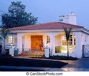 residential exterior - Warm friendly suburban home at dusk.