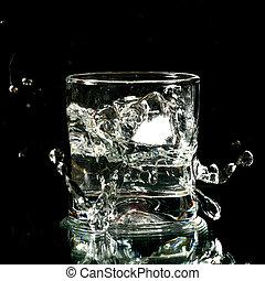 alcohol splash on black background close up