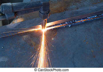 metal cutting with acetylene torch, industrial background