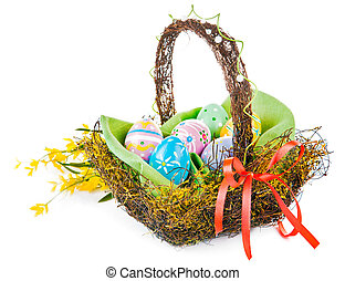 easter eggs in basket with spring flowers - easter egg in...