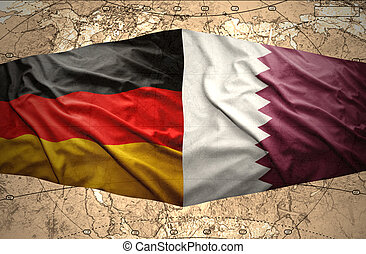 Qatar and Germany - Waving Qatar and German flags on the of...