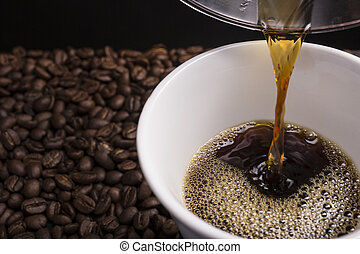Hand Drip Coffee - Hand drip coffee being poured into the...