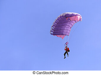 Purple parachute - A purple parachute in a blue sky on a...