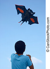 Playing with a paper kite in the sky