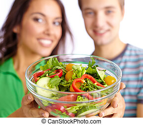 Vegetable salad - Happy couple showing vegetable salad in...