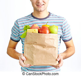 Food for health - Image of paper packet full of healthy food...