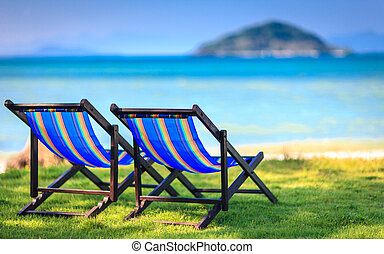 Chairs on beach at tropical island