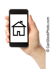 Hand with smart phone and house on white background