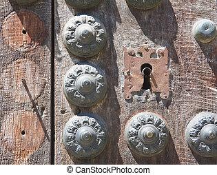 Detail of old door with metal rivets