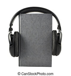 Book with a headphones on it, isolated - Audio-book concept...
