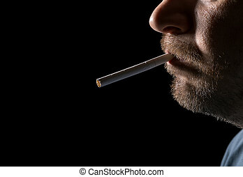 Portrait man smoking cigarette, closeup on black background