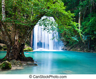 Cliff of Waterfall in deep forest - The Erawan Waterfall was...