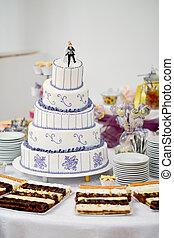 Wedding cake - Tall wedding cake with purple ribbon and...