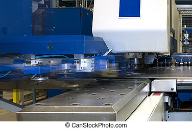 CNC puncing press - A CNC puncing press and robotic sheet...