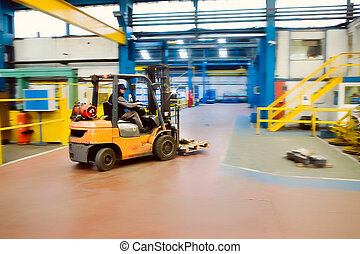Forklift in Factory - Forklift driving through Industrial...