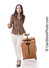 traveling Asian woman - Modern Asian woman running and...
