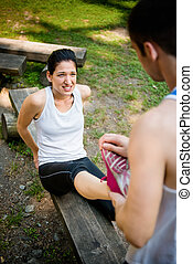 Spasm - when sport hurts - Man helps woman with muscle spasm...