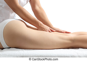 Side view of a woman legs receiving a massage therapy...