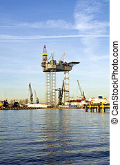 Oil rig construction - An oil rig is being constructed in a...