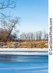 Winter landscape on the river with ice