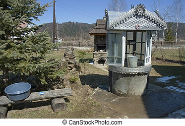 Traditional Ukrainian wishing well. - Objects of traditional...