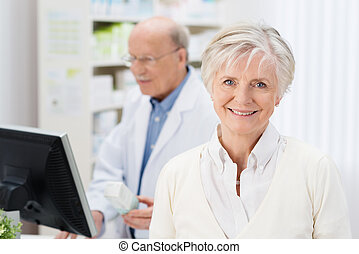 Friendly female pharmacist with a lovely smile