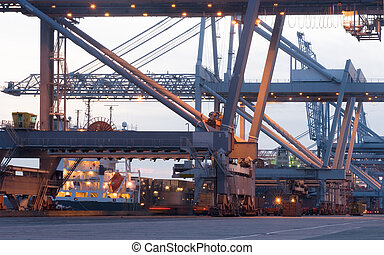Container terminal Cranes - The huge cranes used to load and...