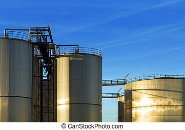 Stainless steel industrial Silos - An industrial plant with...