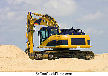 Digger - A Digger on top of a heap of sand